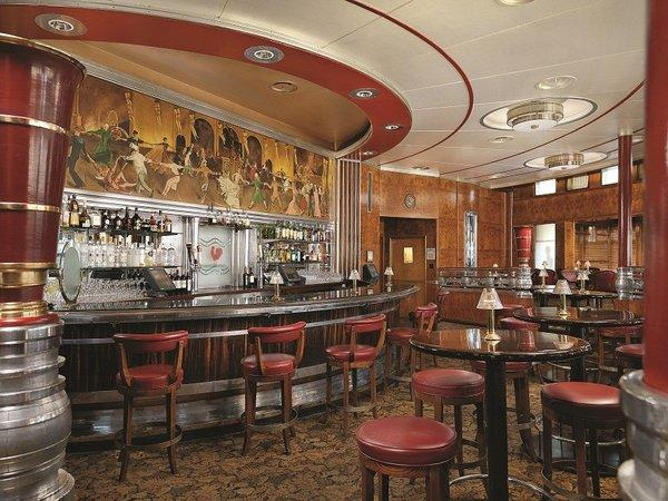 Formerly the first-class lounge, the Observation Bar is furnished with Art Deco tables, chairs and decor. Original artwork still hangs above the curved bar.