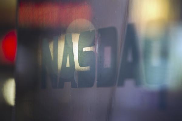 A logo is seen on a window outside of the Nasdaq MarketSite building in New York's Times Square, August 22, 2013.