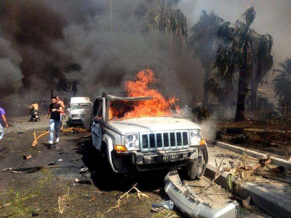 A vehicle burns at the site of an explosion in the northern Lebanese city of Tripoli.