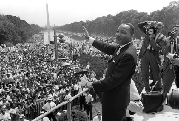"Civil rights leader Martin Luther King Jr. (C) waves to supporters from the steps of the Lincoln Memorial on Aug. 28, 1963 during the March on Washington for Jobs and Freedom. His ""I have a dream"" speech was a defining moment of the civil rights struggle."