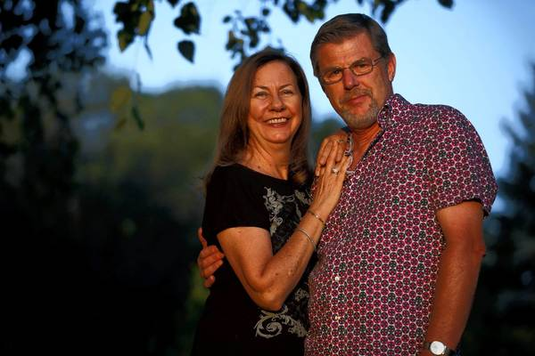 Nancy and Rinus Lammers pose for a portrait at their home Wednesday, Aug. 7, 2013, in Cary, Ill. The pair met at JFK airport in 1989.