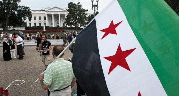 Demonstrators call on President Obama to help the uprising in Syria in a protest in front of the White House on Wednesday.