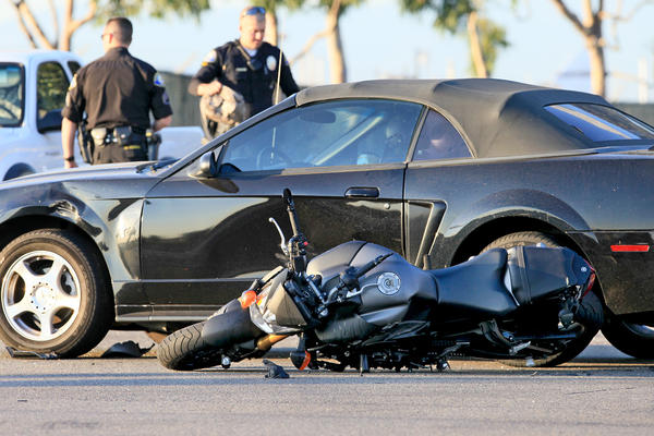 The scene of a seven-vehicle crash in which a motorcyclist was killed along the northbound side of Bristol Street, at Campus Drive in Newport Beach on Thursday.