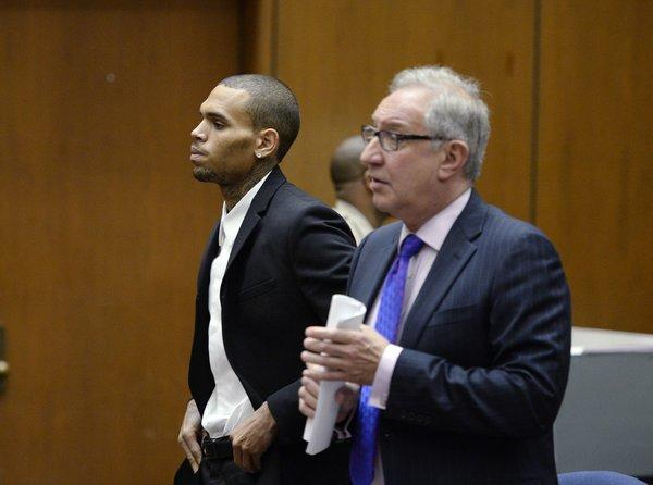 R&B singer Chris Brown appears in court with his attorney for a probation violation hearing on Aug. 16 in Los Angeles.