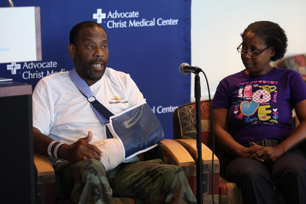 Preston Smith with his wife Rhonda Smith talk to reporters about the chainsaw injury to his hand during a news conference at Advocate Christ Hospital. Smith was attacked by his neighbor with a chainsaw and underwent two hours of a delicate surgery. The doctors say they are hopeful he will regain use of his left hand.