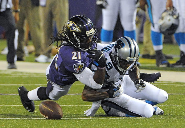 Ravens cornerback Lardarius Webb breaks up a pass intended for Carolina Panthers wide receiver Ted Ginn Jr. during the second quarter of the third preseason game.