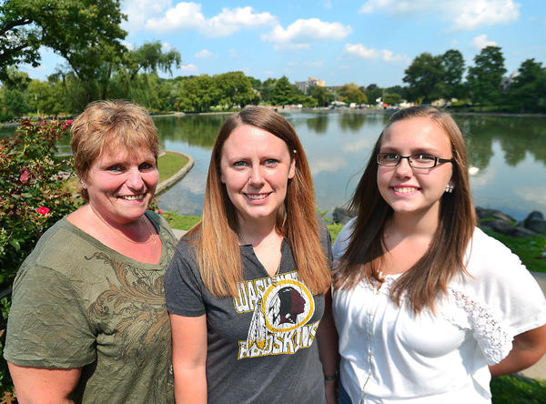 Tia Taylor center and family members Dena French left and Destiny Taylor right are photographed at Hagerstown City Park Tuesday after Tia was named the winner of the landmarks contest.
