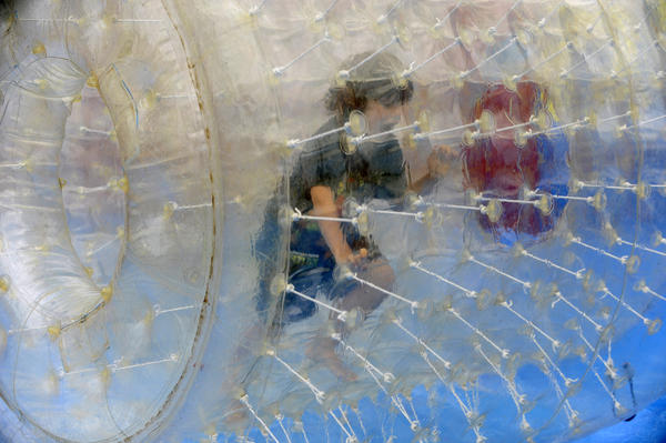 Adrian Montoya, 7, of Nottingham, plays a water-wheel ride at the Maryland State Fair on opening day at the fairgrounds.