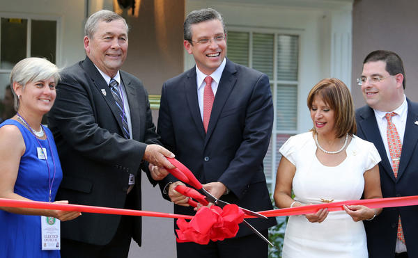 Left to Right, Kissimmee vice-mayor Cheryl L. Grieb, Kissimmee mayor Jim Swan , PR governor Alejandro Garcia Padilla, Betsy Franceschini, regional office director PRFAA and PRFAA executive director Juan Eugenio Hernandez Mayoral during the inauguration and ribbon-cutting ceremony for the new Puerto Rico Federal Affairs Administration Office in downtown Kissimmee, on Friday, August 23, 2013. The opening comes after the office was shuttered four years ago under the previous administration. Puerto Rico Gov. Alejandro Garcia Padilla attended the ceremony. (Ricardo Ramirez Buxeda / Orlando Sentinel)