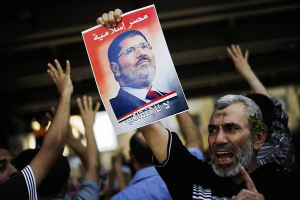 Supporters of the Muslim Brotherhood and ousted President Mohamed Morsi take part in a demonstration on the outskirts of Cairo.