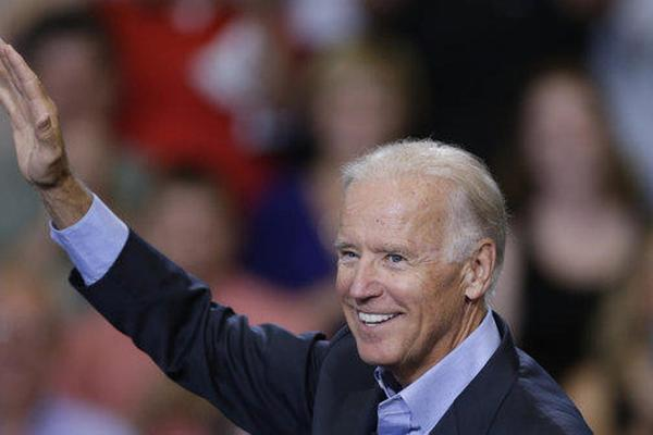 Vice President Joe Biden waves during a visit to Lackawanna College on Friday in Scranton, Pa.