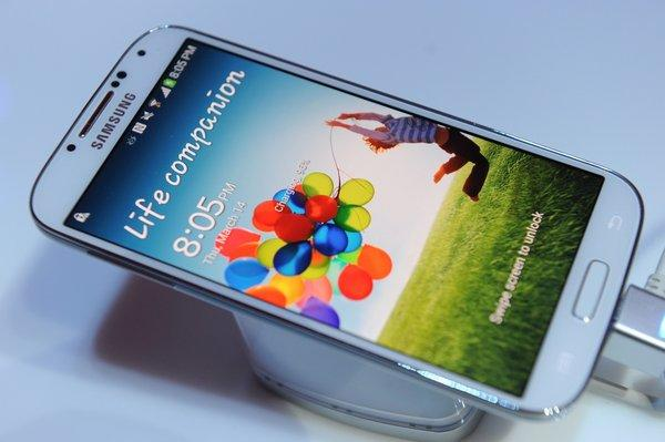 A new Pew survey found that the percentage of people who have Internet access at home rises from 70% to 80% when factoring in smartphones. Pictured, the Samsung Galaxy S4 smartphone.