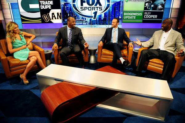 Fox Sports Live host Charissa Thompson, left, NFL player Donovan McNabb, center left, MLB player Gabe Kapler, center right, and NFL player Ephraim Salaam, right, converse on set during rehearsals for Fox Sports 1 at Fox Studios on August 6, 2013 in Los Angeles, California.