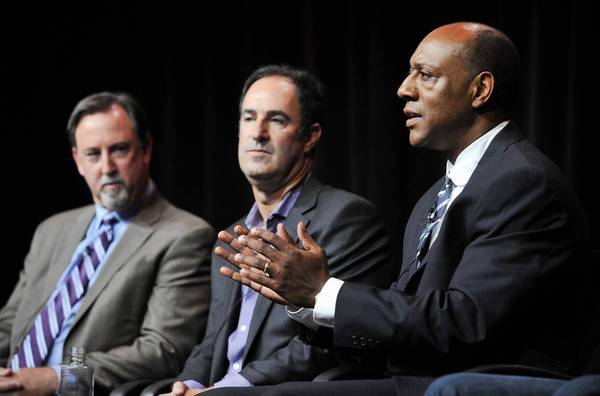 "ESPN senior coordinating producer Dwayne Bray, right, and investigative reporters Mark Fainaru-Wada, left, and Steve Fainaru take part in a panel discussion on the ""Frontline"" documentary ""League of Denial: The NFL's Concussion Crisis"" during a media event this month."