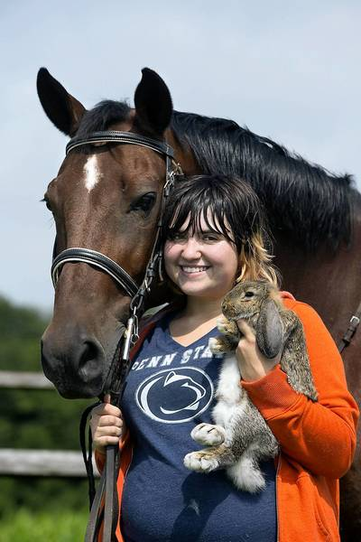 Taylor Gilmore of Dillsburg, York County, with horse Oliver and bunny Stormy.