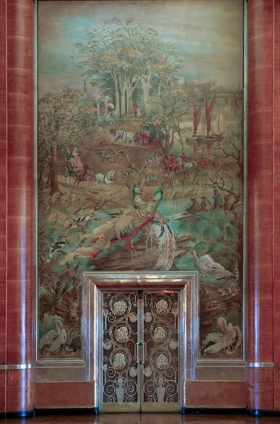 A mural by father-and-son team Walter and Donald Gilbert is above the curlicued bronze doors of the Queen Mary's Grand Salon.