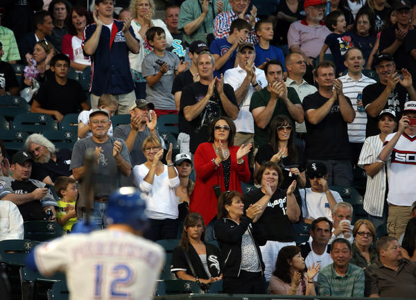 White Sox fans acknowledge A.J. Pierzynski as he comes to bat in the second inning.