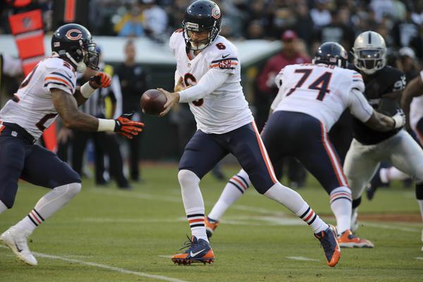 Bears quarterback Jay Cutler hands off the ball to running back Matt Forte.