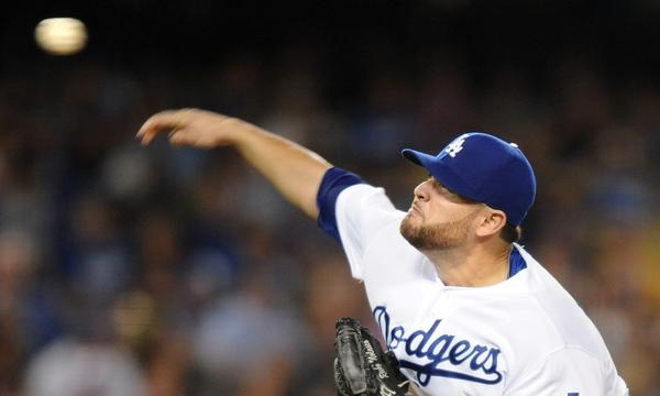 Dodgers starter Ricky Nolasco delivers a pitch during Friday's 2-0 victory over the Boston Red Sox.