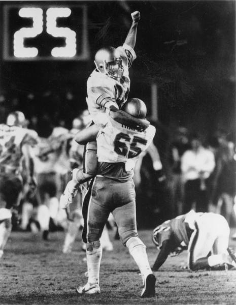 Doug Flutie celebrates after connecting on his famous Hail Mary pass, lifting Boston College to a last-second 47-45 win over Miami in 1984. Getty Images.