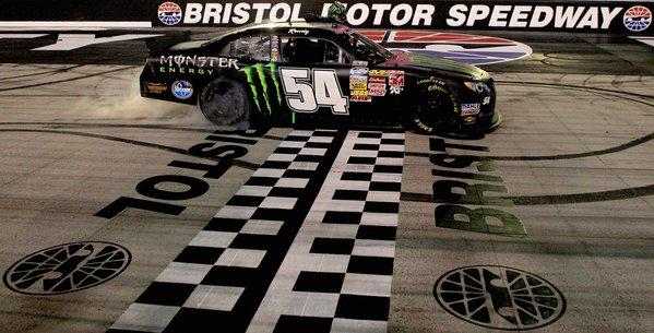 Kyle Busch celebrates his victory at the Nationwide Series Food City 250 at Bristol Motor Speedway on Friday with a burnout.