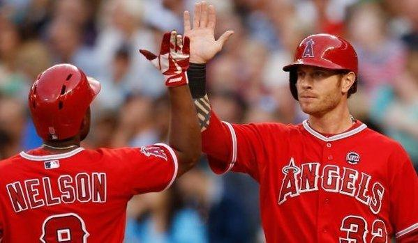 Chris Nelson is congratulated by Josh Hamilton after hitting a two-run home run in the second inning of the Angels' 2-0 victory over the Seattle Mariners on Friday.