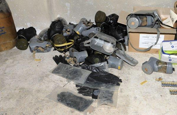 A handout picture released by the Syrian Arab News Agency on Saturday shows gas masks allegedly found in Jobar on the outskirts of the capital, Damascus, alongside what the Syrian government claims to be materials used to make chemical weapons.