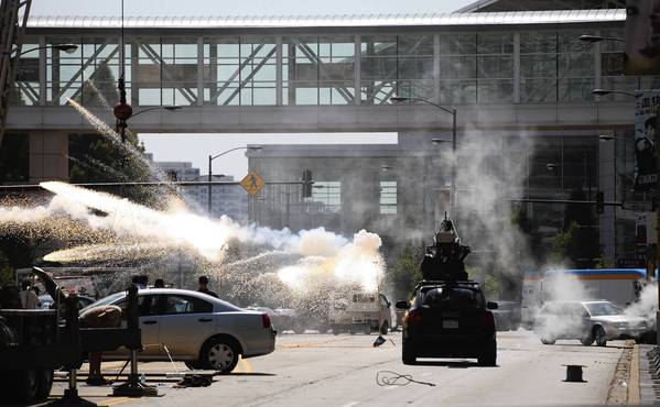 An explosion goes off in the middle of Martin Luther King Dr. at McCormick Place during the filming of 'Transformers 4' in Chicago on Aug. 24.