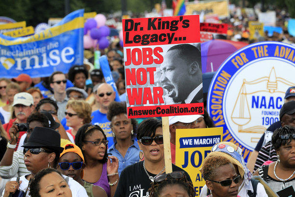 Tens of thousands gathered on the National Mall on Saturday to observe the 50th anniversary of the 1963 March on Washington.