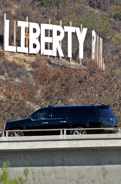 "Traffic passes by a sign that reads ""LIberty?"" on a hillside at the intersection of the 134 and 2 freeways on Wednesday August 21, 2013."