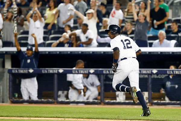 The Yankees' Alfonso Soriano rounds the bases after hitting a two-run home run against the Blue Jays.