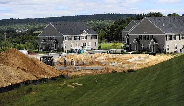 Workers construct new homes in Liberty Village in Upper Saucon Township. Housing construction in the Lehigh Valley appears to be on the rise.