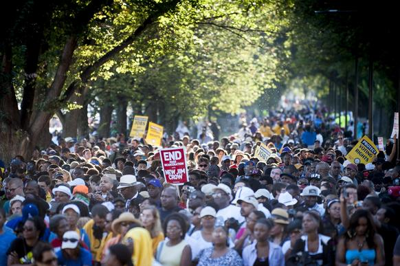 "People arrive at the National Mall to celebrate the 50th anniversary of the March on Washington and the Rev. Martin Luther King Jr.'s ""I Have a Dream"" speech."