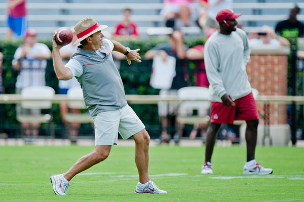 Alabama coach Nick Saban throws a football during practice at Bryant Denny Stadium.