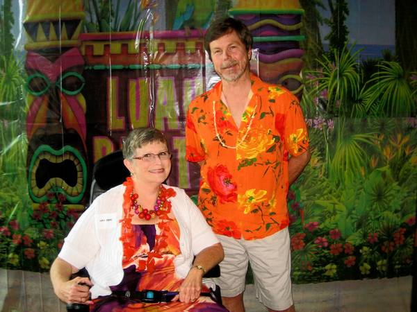 Enjoying the Hawaiian-themed Lehigh Valley Center for Independent Living awards celebration at Lehigh Carbon Community College on Aug. 1 are Executive Director Amy Beck and Rick Walters, who received the Chester 'Bob' Cooyer Key to Living Award.