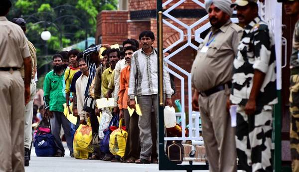 Indian fishermen released by Pakistan line up at the border post in Wagah, India, to cross back into their country.