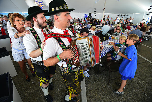 "Adam Levine leads ""The Happy Wanderer March"" with his button accordion Saturday at Augustoberfest celebration in City Center Hagerstown."