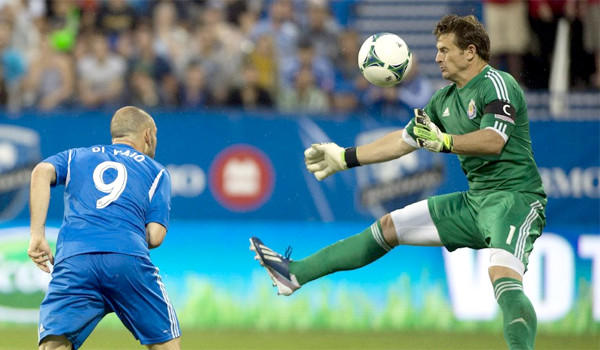Chivas USA keeper Dan Kennedy saves a shot from the Montral Impact's Macro Di Vaio.