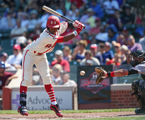 National League player Darius Day scoots away from the ball in the first inning during the 2013 Under Armour All-America Game at Wrigley Field.