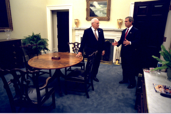 President George W. Bush talks alone with Vice President Dick Cheney prior to addressing the nation on the war in Iraq.