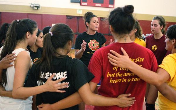 Glendale Community College women's volleyball Coach Yvette Ybarra, center, coaches her team during a practice.