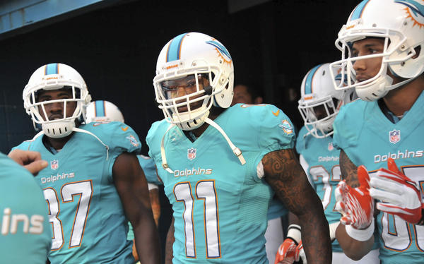 Miami Dolphins wide receiver Mike Wallace (11) takes the field with teammates before a game against the Tampa Bay Buccaneers at Sun Life Stadium. Mandatory Credit: Steve Mitchell-USA TODAY Sports ORG XMIT: USATSI-133188