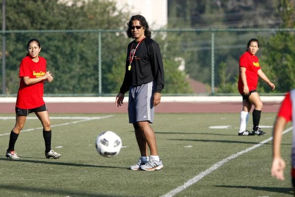 Glendale Community College women's soccer Coach Jorge Mena keeps a close eye on the action during practice.