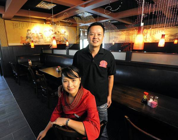 Zuru 'John' Zhang and Xiu Chen are co-owners of Lily Sushi Asian Bistro, which opened Thursday at the old Charlie Brown Steakhouse on Walbert Ave. in South Whitehall Township.