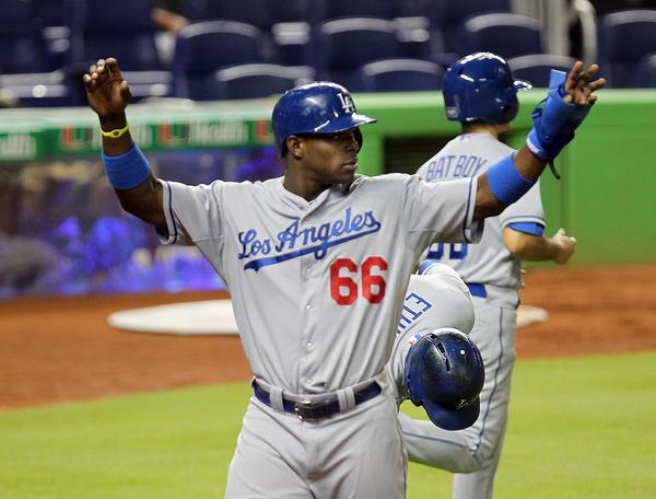 Dodgers outfielder Yasiel Puig reacts after scoring against the Miami Marlins on Wednesday night.