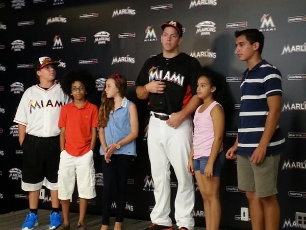Marlins' Logan Morrison gave $1,000 checks to five winners of the first Project LoMo: (from left) Connor Goodman, Joshua Williams, Delilah Lubarsky, Jennifer Santos and Dimitri Godur. (Craig Davis, Sun Sentinel)
