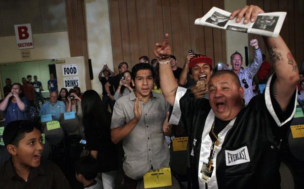 Boxing fans cheer during the action at Glendale Glory 4 at the Glendale Civic Auditorium.
