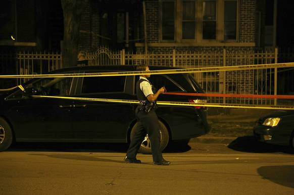 Police investigate the scene where a young female was shot on the 2300 block of N. Kostner Ave. on Aug. 25.