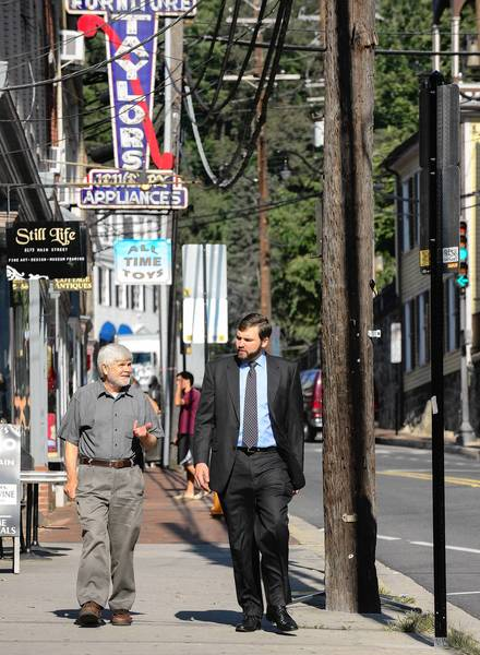The businesses of Historic Ellicott City have reincorporated under one name and with the efforts of Ed Lilley (L) and Andy Hall, plan to hire a town manager to better represent all interests. The pair spend time on Main St. in Ellicott City on Friday morning, August 16, 2013.