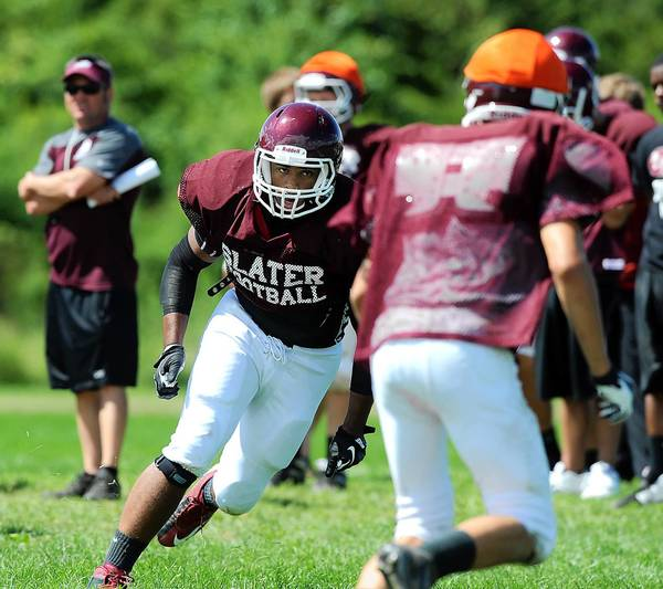 Bangor's RB Phil Vass (left) runs through an offensive drill during afternoon practice.